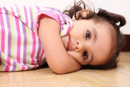two years: Two years old girl lying on the floor