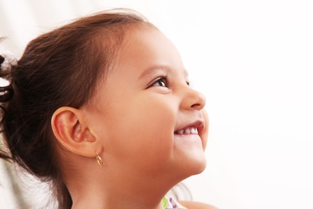 Four years old girl profile looking up and smiling Stock Photo - 8092341