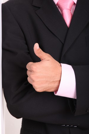 Hand of a businessman expressing positivity, thumbs up, ok sign Stock Photo - 8092379