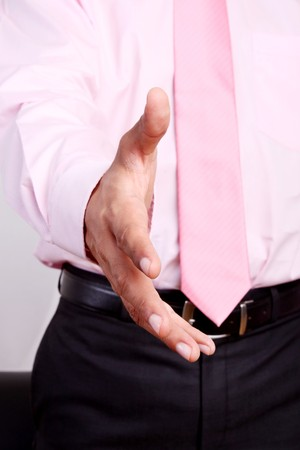 A business man with an open hand ready to greet Stock Photo - 8092398