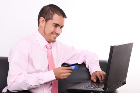 Young businessman buying through internet with credit card photo