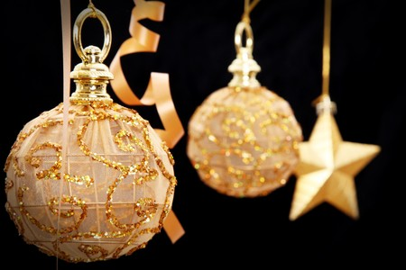 chrstmas: Golden chrstmas balls and star on black background Stock Photo
