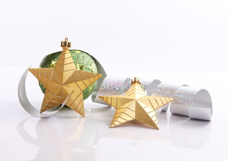 Gold star with serpentine and green ball, xmas image photo