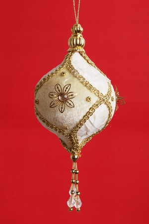 Gold Christmas ball over red background. Xmas Card   photo