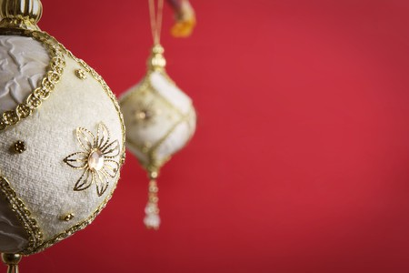 Gold and white christmas balls on red background,  photo