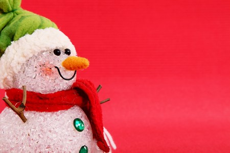 Snowman on red background, space to add text or design, christmas card Stock Photo - 8153325