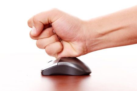 hand hitting a computer mouse over white background. Concept stress Stock Photo - 8305585