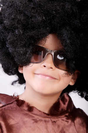 disguised: Happy boy disguised in a wig and glasses Stock Photo