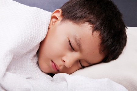 Sleeping child wrapped in a blanket white photo