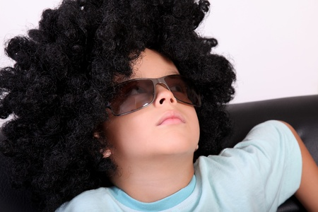 black wigs: Relaxed child resting in a wig and glasses