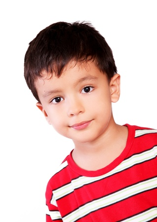 Boy looking at the camera with a small smile over white background