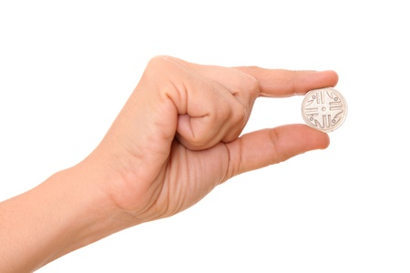 holding hand: Hand holding a coin over white background