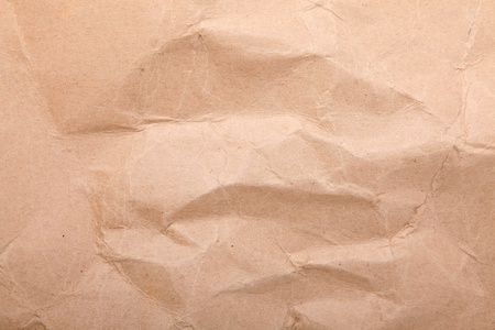 Wrinkled brown paper with space for insert text or design. Background photo