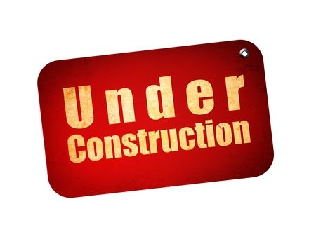Red billboard with under construction text over white background photo