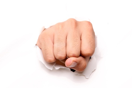 pu�os cerrados: Mano de perforaci�n a trav�s de papel aislado ove blanco fondo Foto de archivo