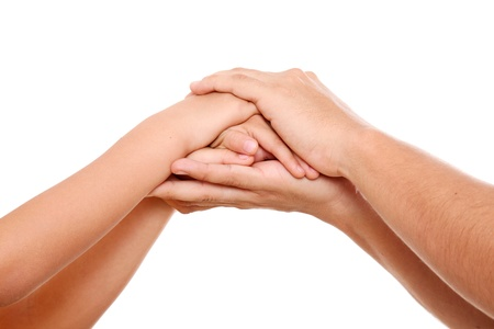 hands clasped: Hands of parents and children together in a sign of love and familiarity