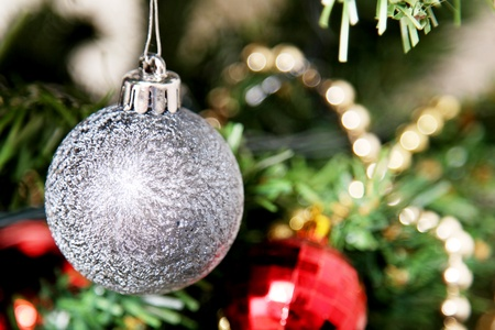 Christmas ball hanging from a tree decorated photo