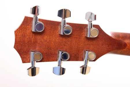 Back of the headstock of the guitar over white background photo