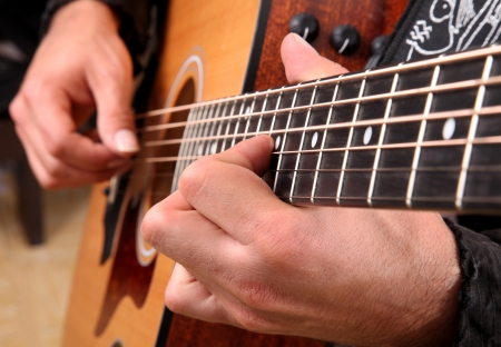 acoustic guitar: Hands playing guitar in diagonal position Stock Photo