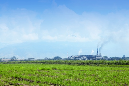 Landscape with factories polluting the environment and nature photo