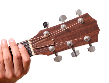 Headstock of the guitar with hands touching  photo