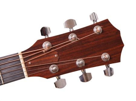 Wooden headstock of the guitar  over white background  photo