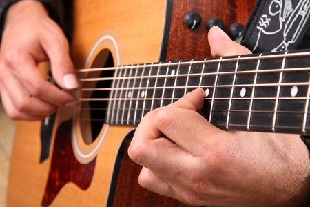 melodies: Hands intrepret melodies on a guitar. Concept musical