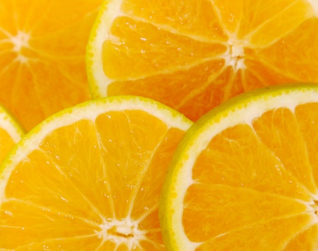 Yellow orange background with  five cut fruits Stock Photo - 8912466