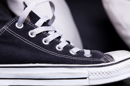 Black and white modern shoe over black and white background photo