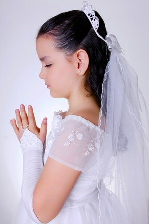 Girl praying concentrated in your first communion  photo