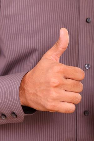 Hand of man with thumb upward. Ok signal.  photo