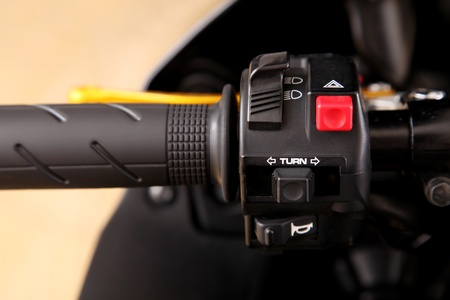 throttle: Motorcycle Throttle closeup with red and black buttons . Background Stock Photo