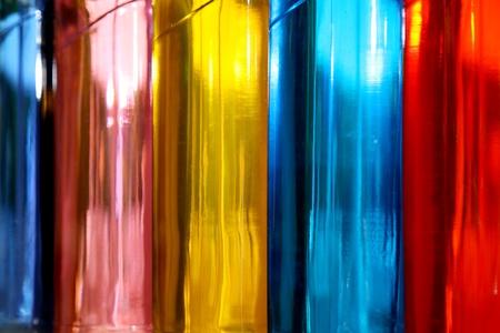 Blue,pink,yellow,red,orange bottles. Background photo