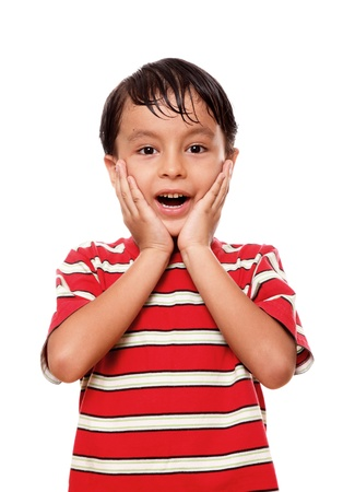 Child with the hands on his face in signal of surprise   photo