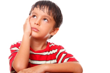 teen boy face: Child with pensive and sad expression over white background