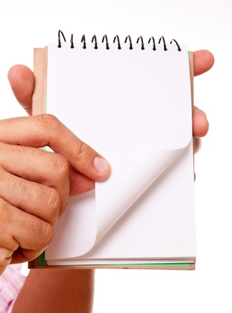 Hand showing a blank notebook with space in blank for insert text or design photo
