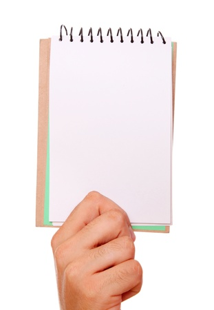 hand holding a notebook over white background photo