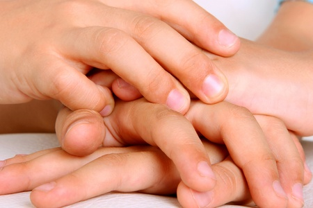 Hands of children together as a symbol of friendship, brotherhood and teamwork photo