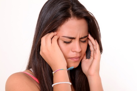 beautiful sad: Woman with a severe headache with the hands in the head