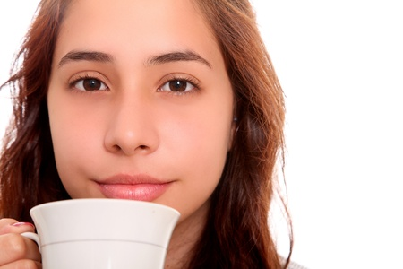 Serious woman carrying a coffee cup to his mouth photo