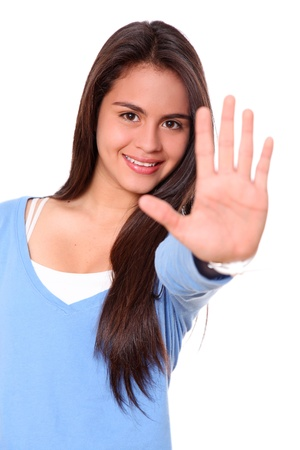Woman smiling and showing his hand in signal of stop Stock Photo - 9314795