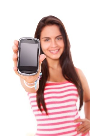 hispanic women: Woman showing a black and chrome cellphone  over white background Stock Photo