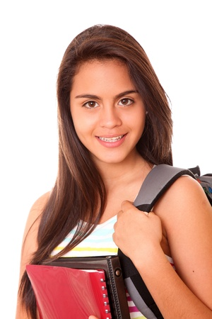 Girl student with a bag on her back and red books on her hands Stock Photo - 9340031