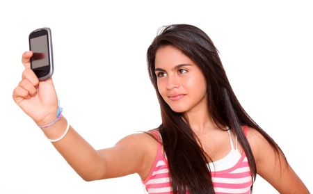 Beautiful young woman taking a picture with her cell phone photo