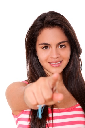 Young woman pointing over white background. teen Stock Photo - 10002605