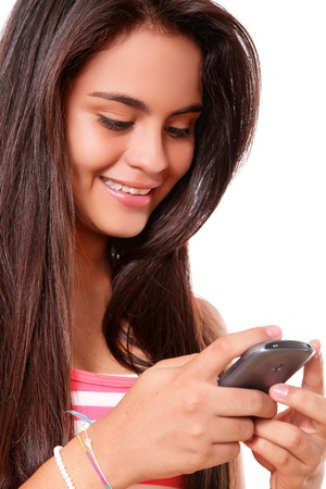 young woman using a cell phone over white background Stock Photo - 10002641