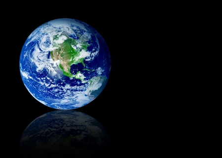 Earth planet with reflection over black background. Space to insert text or design photo