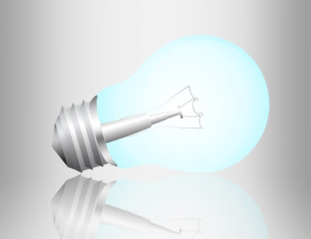 blue and gray electric bulb with reflection over gray background photo