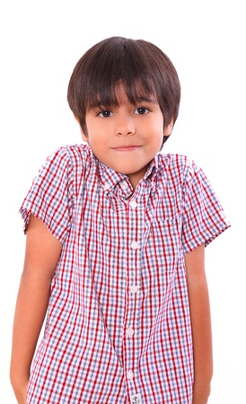 shrugging: little boy shrugging isolated over white background. child