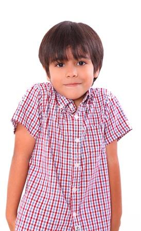 little boy shrugging isolated over white background. child